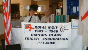 Picture of Roy Tynan & Harry Fine manning the welcome desk at a Reunion